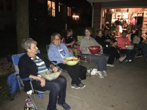 Neighbors gather to visit and pass out candy!